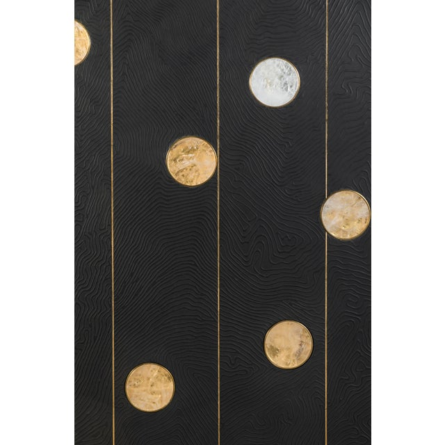 Art wall panel by Paul Marra with textured pattern, hand cut rock crystal, brass. The texture is a hand-applied faux bois...