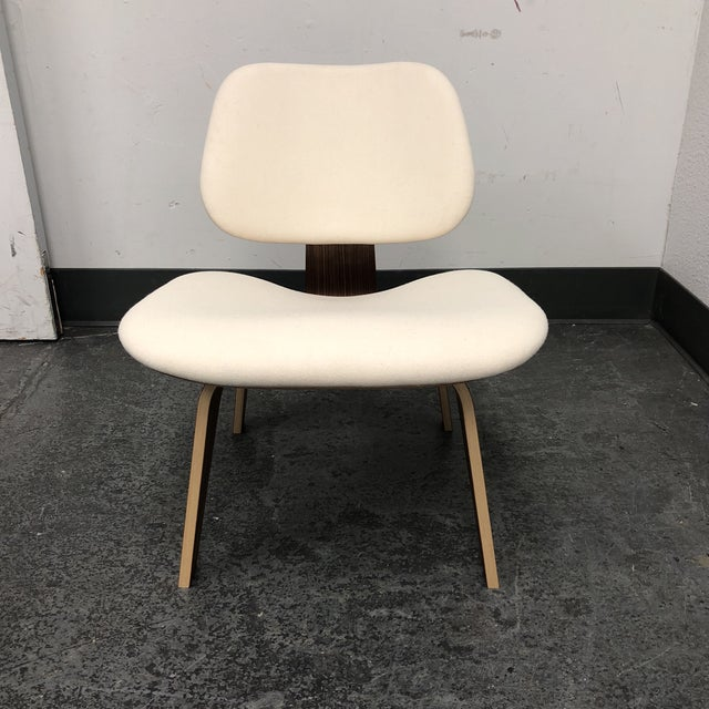 Design Plus Gallery presents a Eames Molded Plywod Chair by Design Within Reach. Design by Charles & Ray Eames. Labeled by...