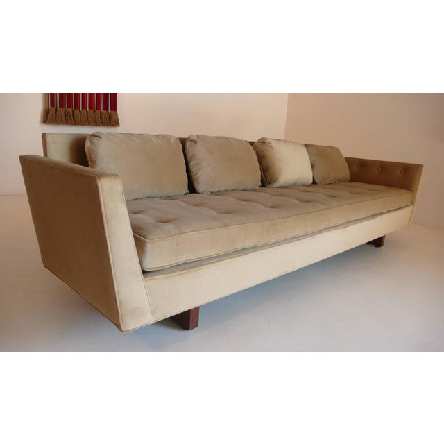 Exquisite pair of Edward Wormley designed split-arm sofas manufactured by Dunbar in the early 1950s. Completely restored...