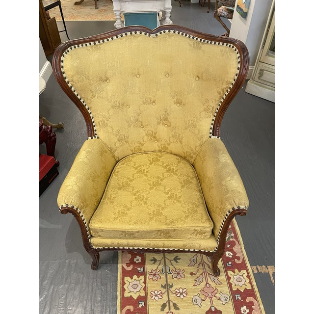 French wingback chair. Tufted buttons. Brocade fabric. French cabriolet legs. Original retain price for 1,500
