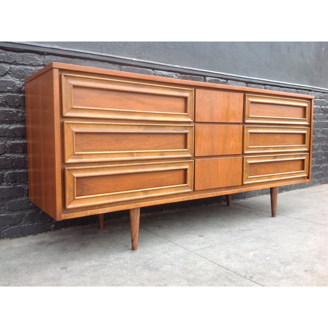 A mid-century 9 drawer walnut dresser. In great condition with lots of storage . Union made.