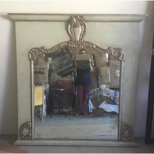 This is a very beautiful mirror. The mirror is slightly antiqued and the finish on the carving is a gold/silver leaf. The...