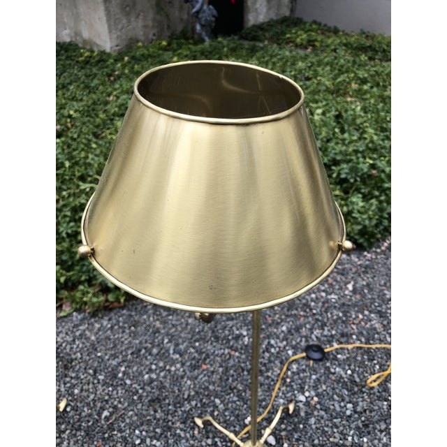 """Handsome and practical, a pair of """"Essex"""" tripod reading lamps in brushed brass. The lamps can be adjusted both in height..."""