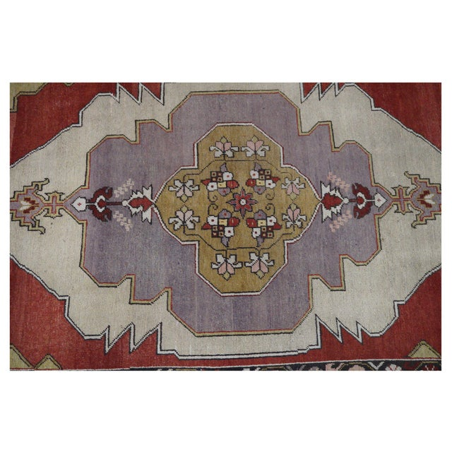 This beautiful vintage Oushak rug is hand-knotted, 100% wool, made in Turkey, Ushak region. It features a geometric...