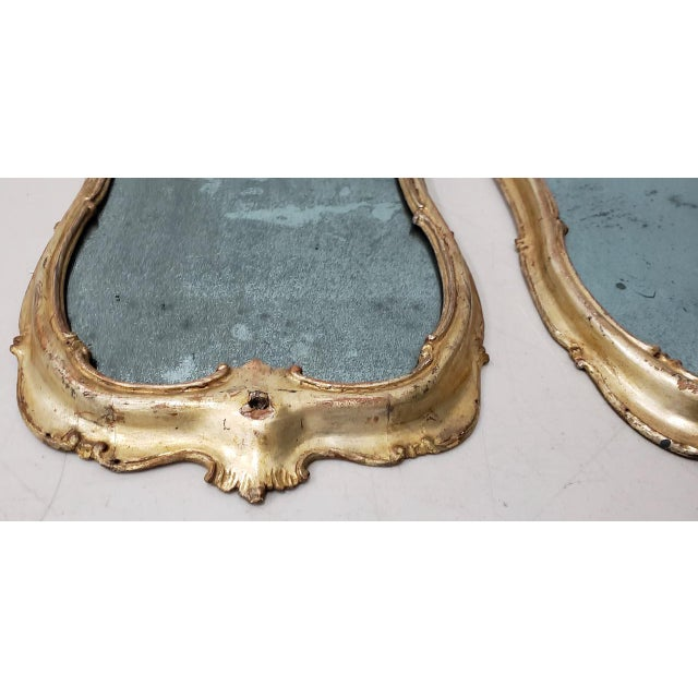 Matching Pair of 19th Century Italian Hand Carved & Gilded Mirrors Fabulous pair of antique mirrors from Italy. Each...