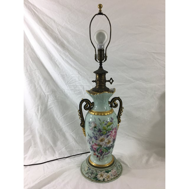 This lovely pair of hand-painted lamps are decorated with fantastic springtime florals. Recently rewired. Dates to the...