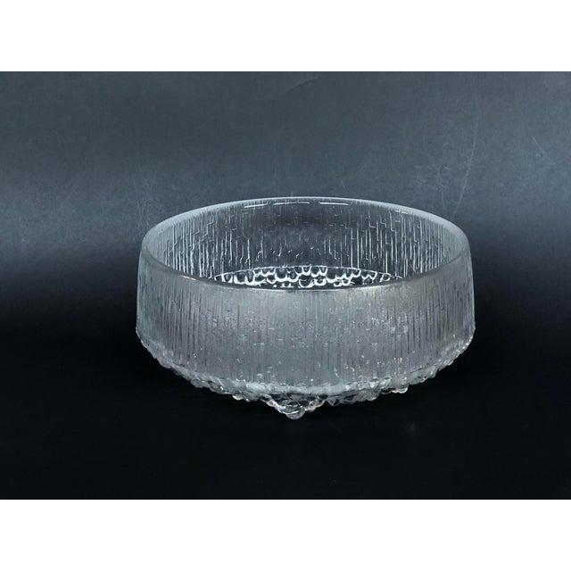 Designed by Finnish artist Tapio Wirkkala, this vintage circa 1970s modern glass bowl will make a striking table...