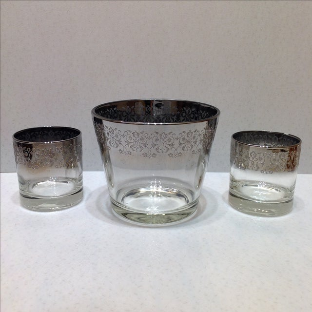 Offered is a vintage embossed silver ombré ice bucket and cocktail glass set. Set includes one ice bucket and two old...