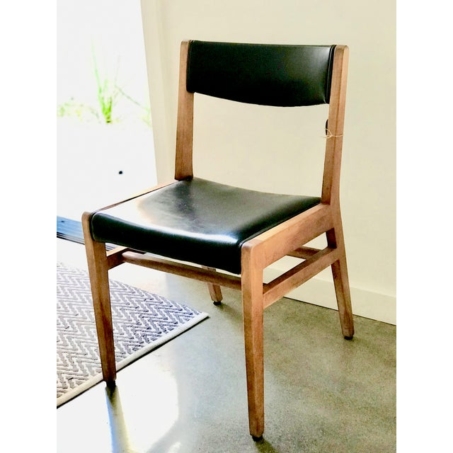 Manufactured in California, this Gunlocke Chair has padded black leather back and seat all original. Makers marks...