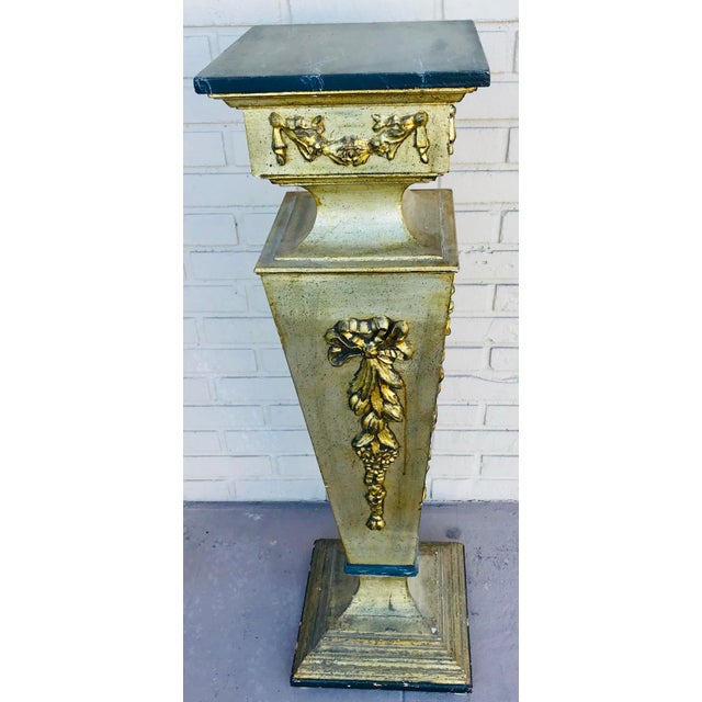 Gorgeous golden with black top gilded pedestal. Great for any room