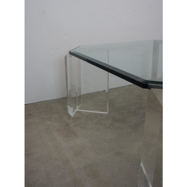 This stylish and chic Lucite and glass cocktail table is by the iconic American designer Charles Hollis Jones and it date...
