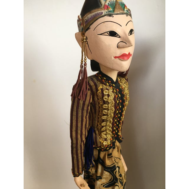 Indonesian Rod Puppets Pair Striking puppets made from wood and bamboo and fabric - a traditional Indonesian rod puppet....