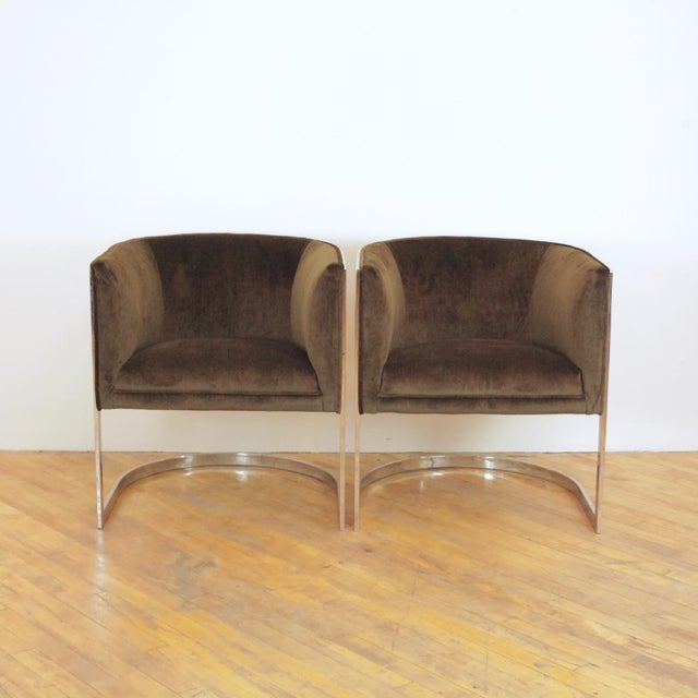 A classy pair of cantilever barrel chairs designed by Jules Heumann for Metropolitan Furniture in San Francisco featuring...