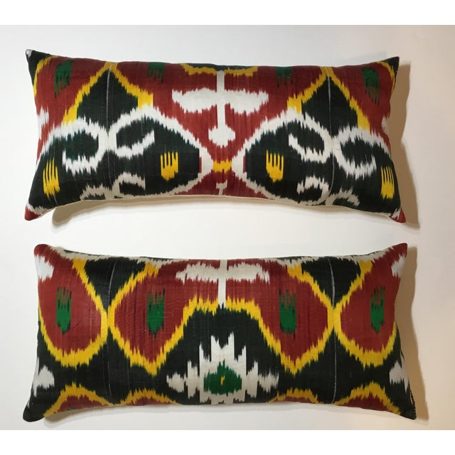 Beautiful pair of pillows made of silk Ikat textile, vibrant colors of red-salmon black, white And yellow-muster .fresh...