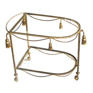 A Chic Pair of Italian Mid-Century Hollywood Regency Gilt-Tole Drinks-Bar Carts With Glass Shelves Preview