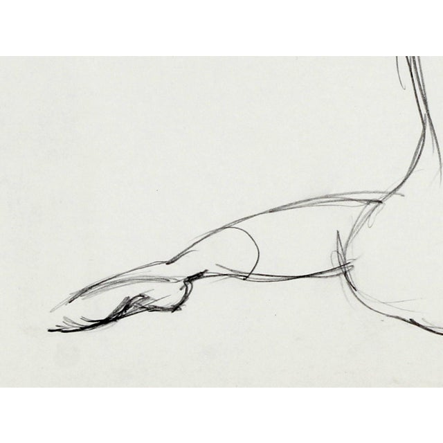 This 1974 graphite on paper sketch of a ballerina stretching is by Northern California artist Hugh Wiley (1922-2013)....
