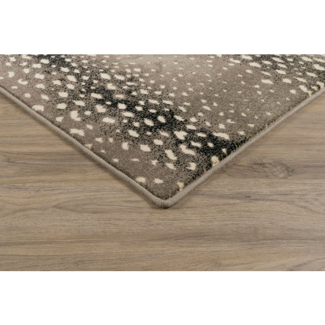 Ground the look and feel of your interior with rich silver tones and dark accents. The lively print of the 'Deerfield...