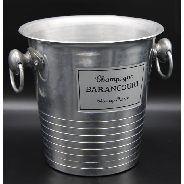 """A superb Vintage French Champagne Ice Bucket. The color is silver, """"Champagne Barancourt Bouzy-French"""" in black script;..."""