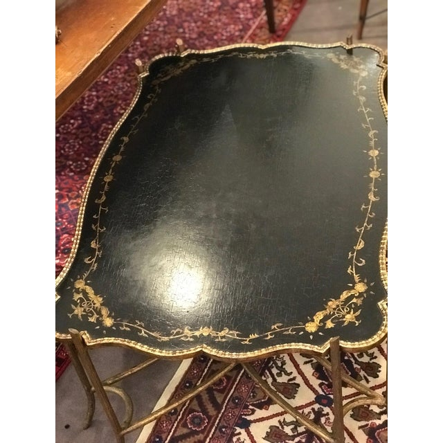 Beautiful chinoiserie coffee table with tray top in lacquer/parcel gilt finish rests on gilt metal faux bois base....