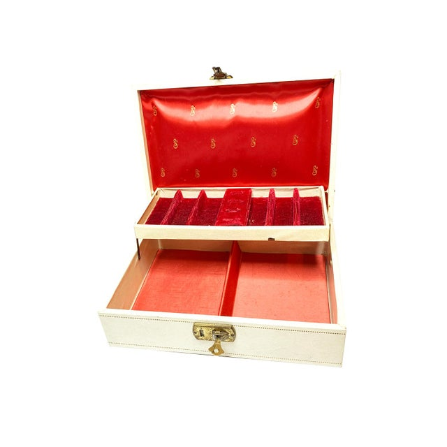 Vintage mid century MELE white jewelry box with royal red interior. The exterior has white leatherette finish with gold...