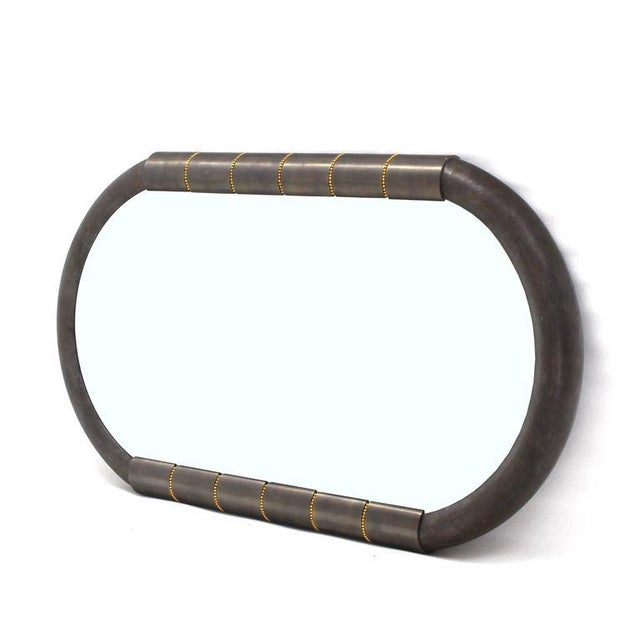 Very nice Mid-Century Modern racetrack shape metal and bronze frame mirror.