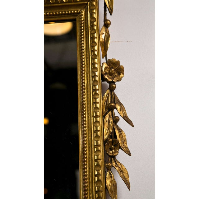 Beautiful Italian giltwood mirror, the oblong rectangular glass surmounted in shaped and annulated frame, the top...