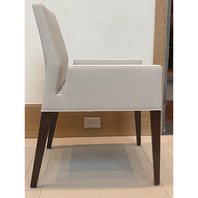 This dining arm chair has a sophisticated silhouette and is as comfortable as it is stylish. Maple solid wood construction...