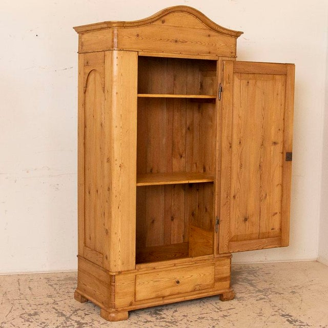 It is the beauty of the warm, aged wood that captures your attention in this pine armoire that stands almost 6 1/2ft tall....