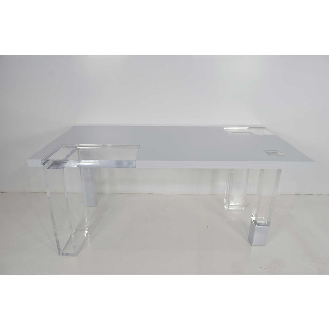 A Lucite and white lacquer table. Ideal for a work table, entry table or display table. Can also be used as a desk or...