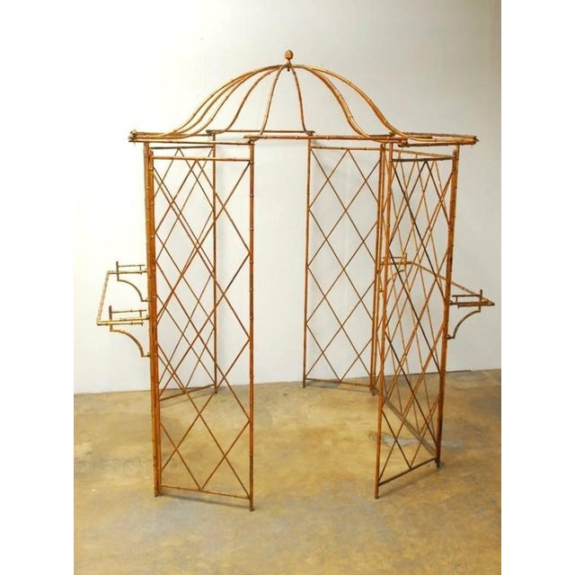 Fantastic Hollywood Regency gilt metal faux-bamboo garden gazebo featuring a pagoda roof with ten arm supports and topped...