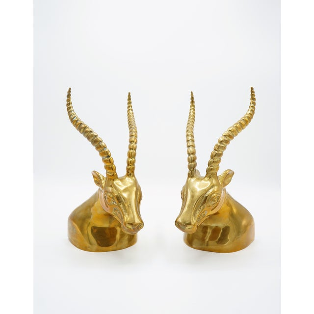Well executed pair of weighted brass gazelle busts with curling antlers. Each of these modern sculptures would make a...