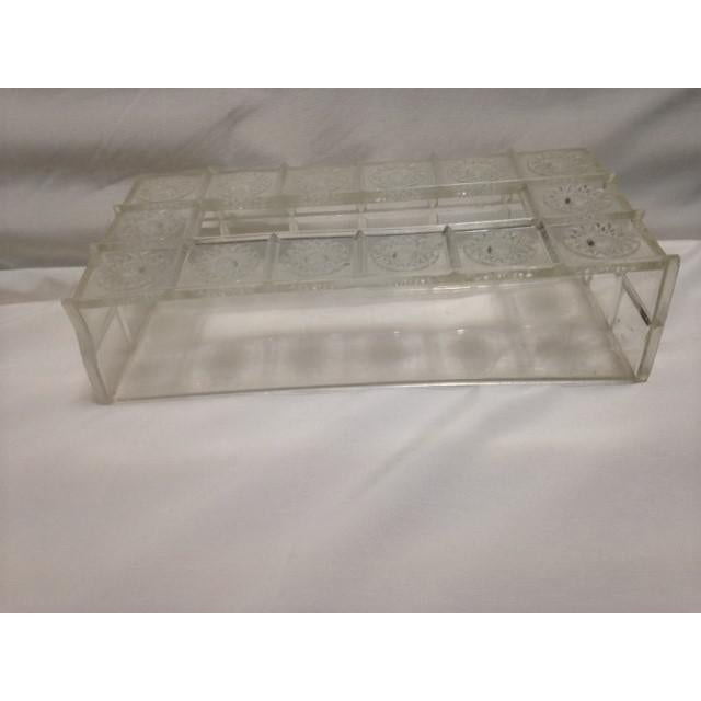 "Mid-Century Lucite tissue holder, 10 1/4"" wide, 2 3/4"" high, 5"" depth, has some discoloration, one side is slightly bent,..."