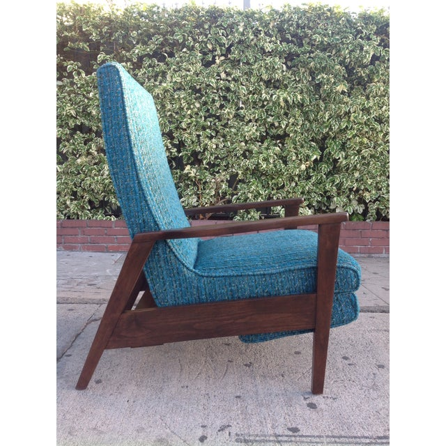 A stunning example of mid-century modern design at its finest. Beautiful original fabric in almost mint condition. Solid...