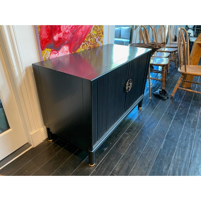 Tambour doors slide smoothly to reveal open space to storage large piece . Freshly lacquered with original hardware...