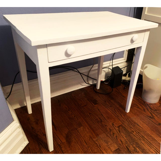 Vintage desk painted in white chalk paint. Great for a small space, powder room and/or children's room. Transitional...