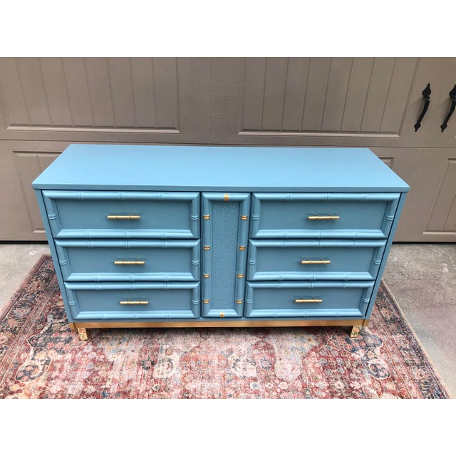 Gorgeous redesigned vintage dresser. This Benjamin Moore cabinet paint color is just so pretty. Even the color name is...