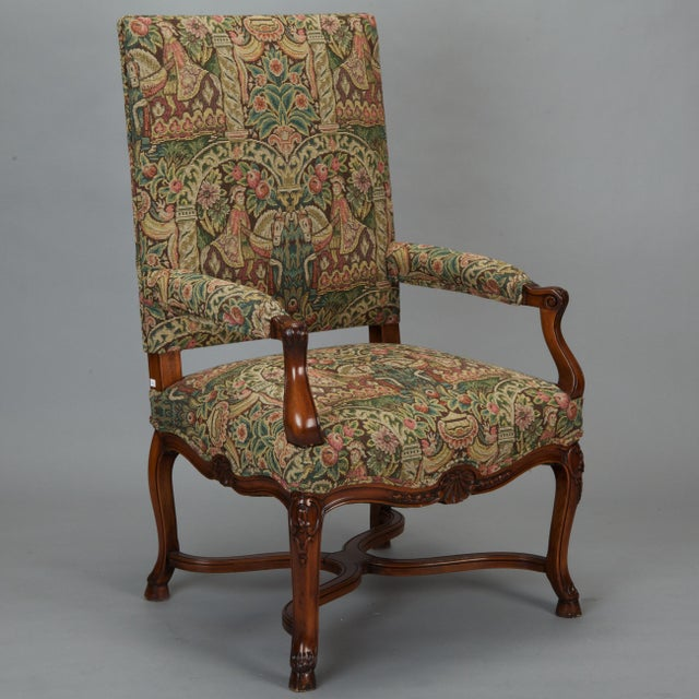 Generously sized French armchair has beautiful carved details and is newly upholstered in traditional, old-world style...
