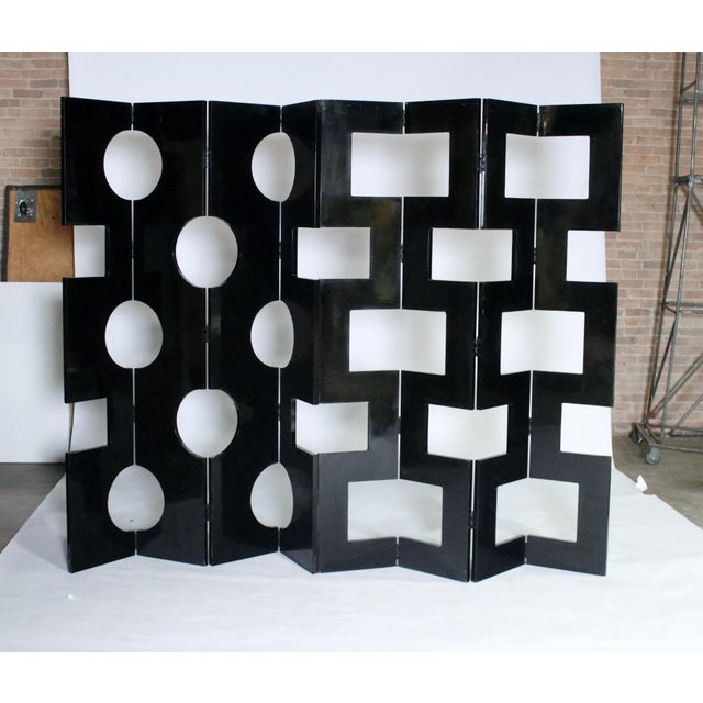 2- 4 panel modernist black lacquered room dividers sourced from Saks 5th Avenue. Each panel is lacquered on both sides one...