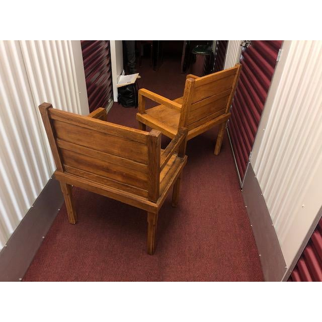 Great pair of wood chairs with wide seat design, rustic look and solid, sturdy craftmanship. Kind of mission-style and...