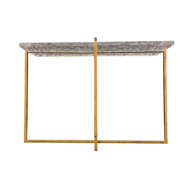 Rectangular, faceted tabletop and antique gold, metal frame console table. Perfect for a modern home.