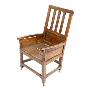 Mid 19th Century Wooden Chair With Carvings on Brass Casters