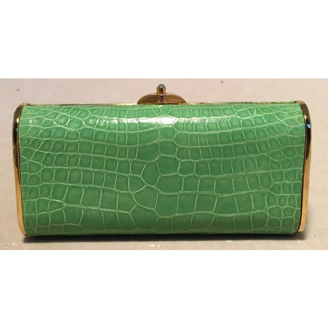 Judith Leiber Vintage Mini Green Alligator Clutch Minaudiere in excellent condition. Green alligator leather trimmed with...