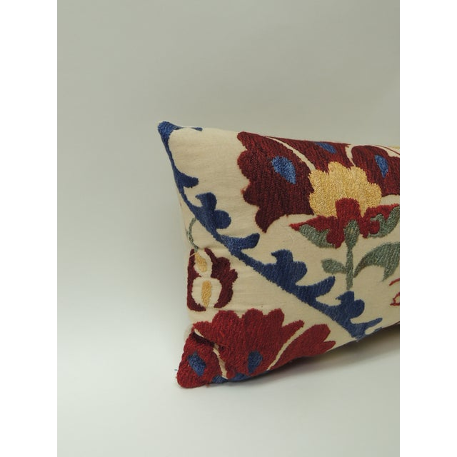 "Vintage colorful floral embroidery ""Suzani"" decorative bolster pillow. Hand embroidered silk floss threads on natural..."
