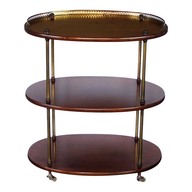 A handsome English 3-tier solid mahogany oval etager with brass mounts For Sale