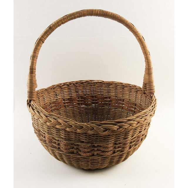 Vintage round woven reed basket with woven braid accent band. Overall patina , few small breaks in reeds. Height does not...