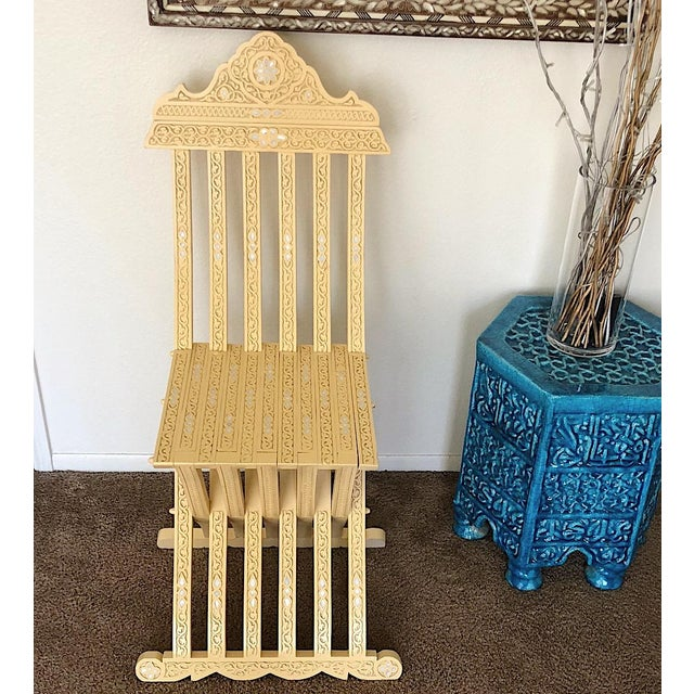This beautiful chair hand-carved by hand and inlaid with natural mother of pearl, the wood is beach wood. Chair can fold...