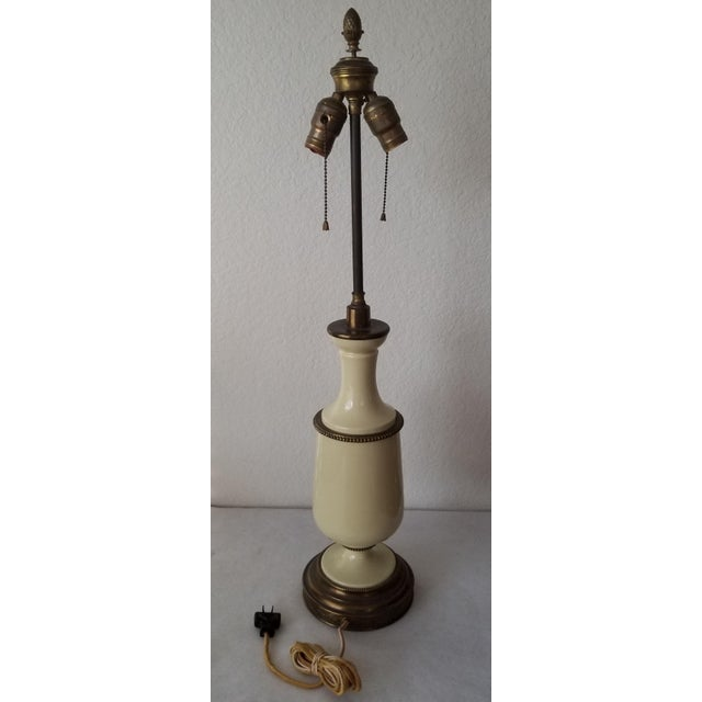We love this extraordinary antique table lamp for the all original parts and working condition in its 100 year old...