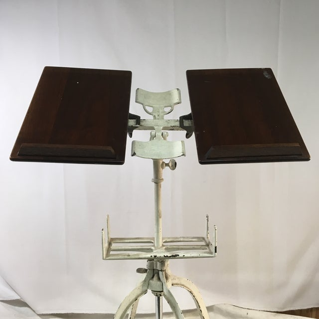 This antique book stand was typically used to display reference books such as thesauruses or dictionaries. It can also be...