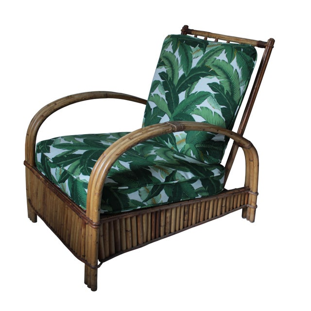 This gorgeous 1930s-40s rattan lounge chair is a special find for your living room or patio. The original spring loaded...