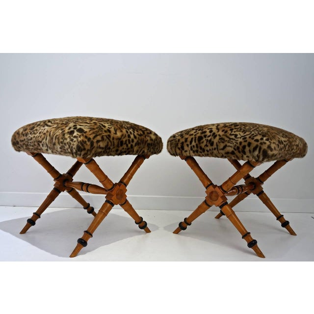 This pair of Biedermeier style X-frame stools have been newly upholstered in a woven exotic leopard pattern faux fur. The...